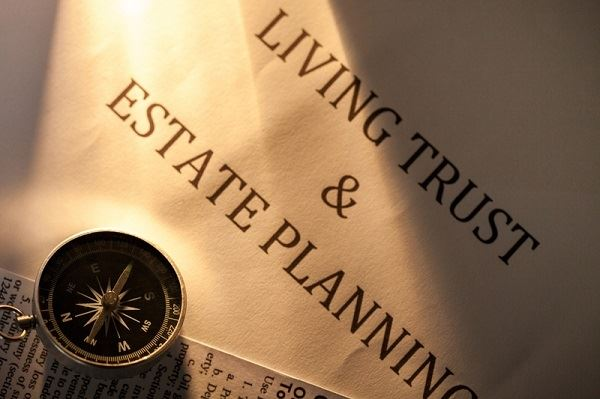 "Papers that say ""Living Trust & Estate Planning"""