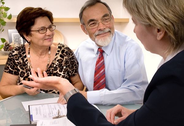 Older couple speaking to a lawyer